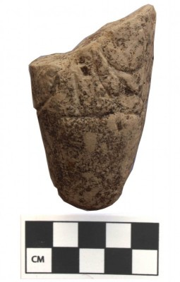 Figure 5. Broken Yarmoukian pebble figurine from WQ117.